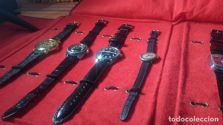 Relojes de pulsera: Botita cartera con reloj de cuerda Olma,los otros 7 relojes de cuerda que contiene se regalan - Foto 11 - 113733395