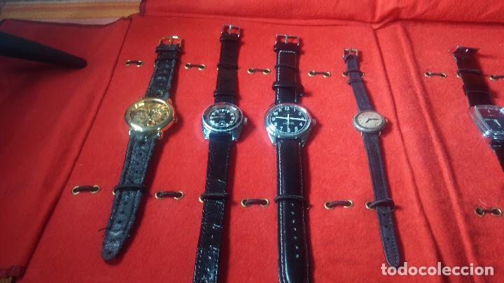 Relojes de pulsera: Botita cartera con reloj de cuerda Olma,los otros 7 relojes de cuerda que contiene se regalan - Foto 16 - 113733395