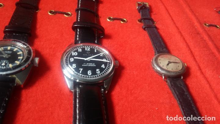 Relojes de pulsera: Botita cartera con reloj de cuerda Olma,los otros 7 relojes de cuerda que contiene se regalan - Foto 22 - 113733395
