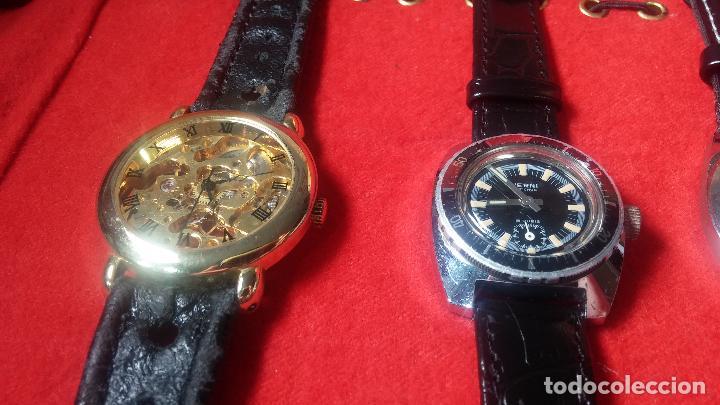 Relojes de pulsera: Botita cartera con reloj de cuerda Olma,los otros 7 relojes de cuerda que contiene se regalan - Foto 23 - 113733395