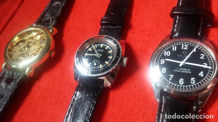 Relojes de pulsera: Botita cartera con reloj de cuerda Olma,los otros 7 relojes de cuerda que contiene se regalan - Foto 24 - 113733395
