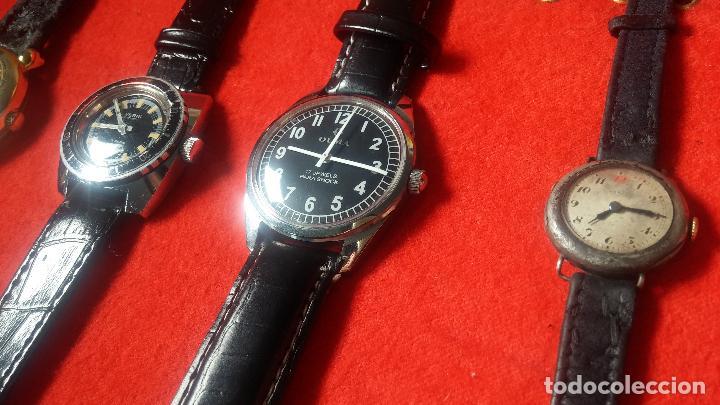 Relojes de pulsera: Botita cartera con reloj de cuerda Olma,los otros 7 relojes de cuerda que contiene se regalan - Foto 25 - 113733395