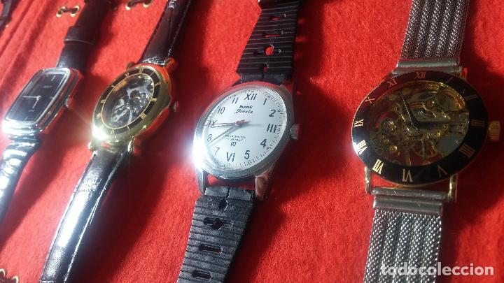 Relojes de pulsera: Botita cartera con reloj de cuerda Olma,los otros 7 relojes de cuerda que contiene se regalan - Foto 29 - 113733395