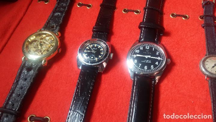 Relojes de pulsera: Botita cartera con reloj de cuerda Olma,los otros 7 relojes de cuerda que contiene se regalan - Foto 34 - 113733395