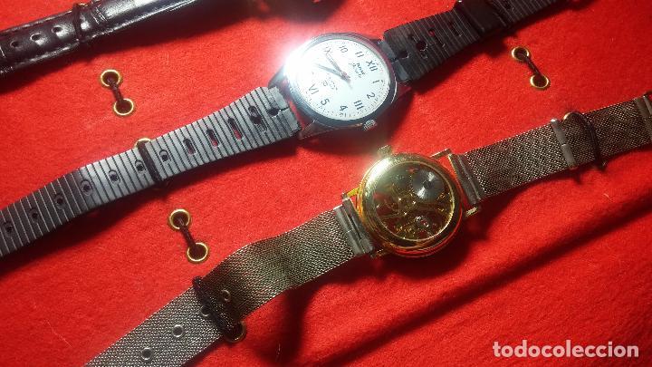 Relojes de pulsera: Botita cartera con reloj de cuerda Olma,los otros 7 relojes de cuerda que contiene se regalan - Foto 37 - 113733395