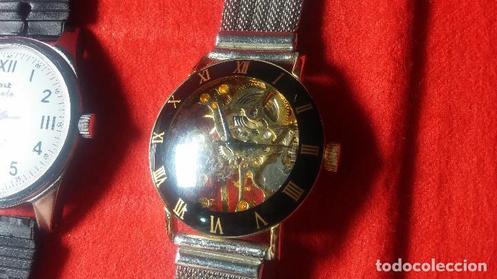 Relojes de pulsera: Botita cartera con reloj de cuerda Olma,los otros 7 relojes de cuerda que contiene se regalan - Foto 41 - 113733395
