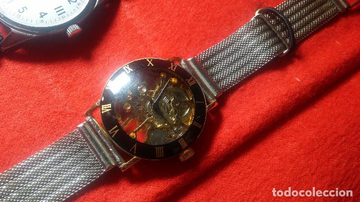 Relojes de pulsera: Botita cartera con reloj de cuerda Olma,los otros 7 relojes de cuerda que contiene se regalan - Foto 43 - 113733395