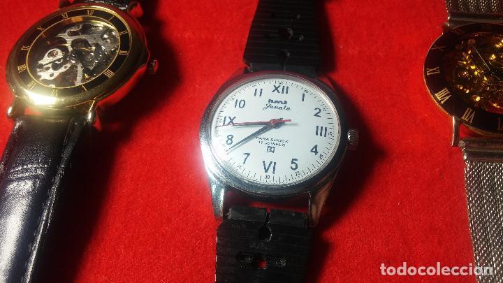 Relojes de pulsera: Botita cartera con reloj de cuerda Olma,los otros 7 relojes de cuerda que contiene se regalan - Foto 47 - 113733395