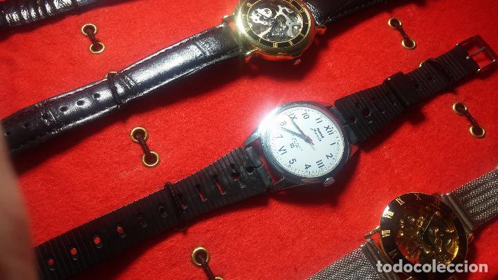 Relojes de pulsera: Botita cartera con reloj de cuerda Olma,los otros 7 relojes de cuerda que contiene se regalan - Foto 51 - 113733395