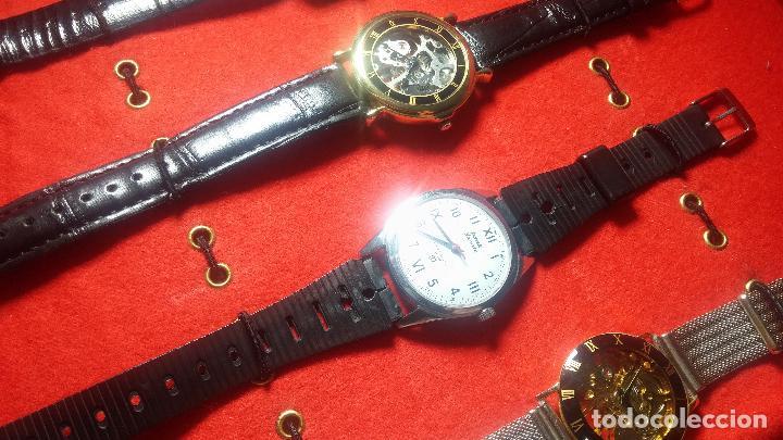 Relojes de pulsera: Botita cartera con reloj de cuerda Olma,los otros 7 relojes de cuerda que contiene se regalan - Foto 52 - 113733395