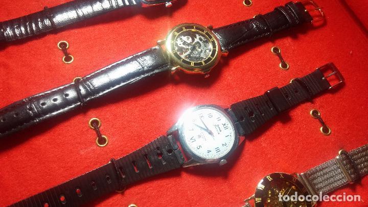 Relojes de pulsera: Botita cartera con reloj de cuerda Olma,los otros 7 relojes de cuerda que contiene se regalan - Foto 53 - 113733395