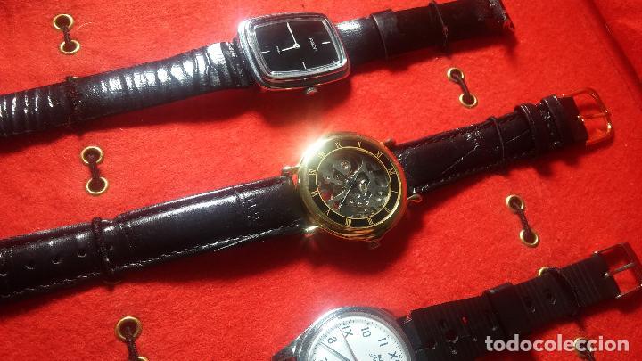 Relojes de pulsera: Botita cartera con reloj de cuerda Olma,los otros 7 relojes de cuerda que contiene se regalan - Foto 56 - 113733395