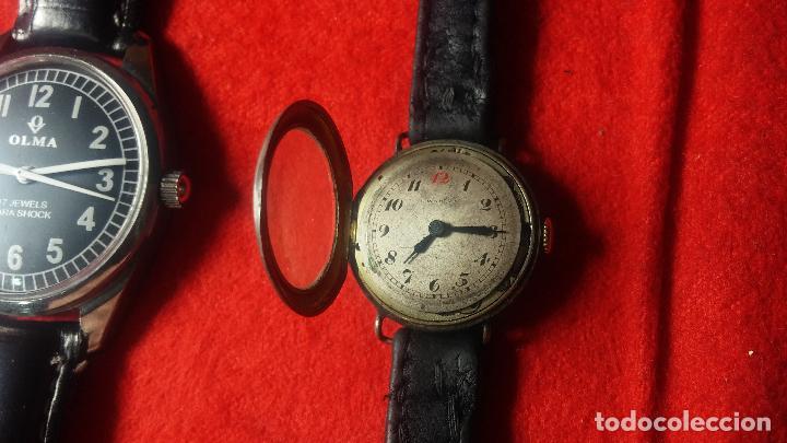 Relojes de pulsera: Botita cartera con reloj de cuerda Olma,los otros 7 relojes de cuerda que contiene se regalan - Foto 63 - 113733395