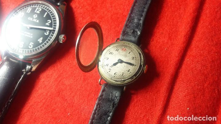 Relojes de pulsera: Botita cartera con reloj de cuerda Olma,los otros 7 relojes de cuerda que contiene se regalan - Foto 64 - 113733395