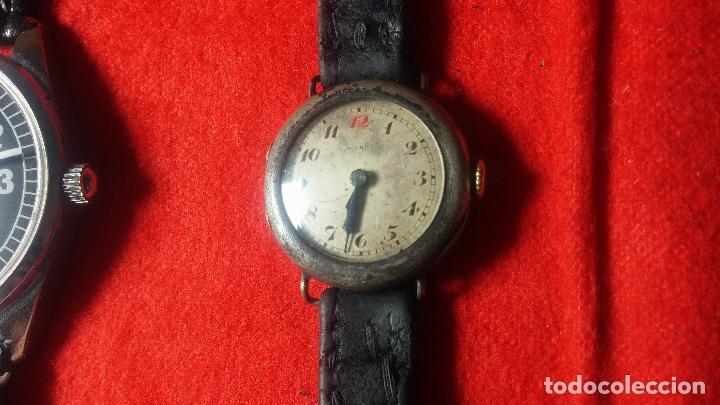 Relojes de pulsera: Botita cartera con reloj de cuerda Olma,los otros 7 relojes de cuerda que contiene se regalan - Foto 65 - 113733395