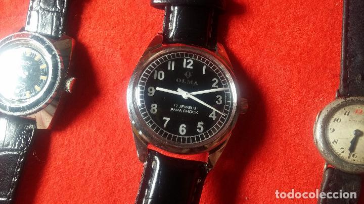 Relojes de pulsera: Botita cartera con reloj de cuerda Olma,los otros 7 relojes de cuerda que contiene se regalan - Foto 69 - 113733395