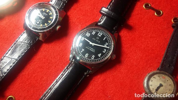 Relojes de pulsera: Botita cartera con reloj de cuerda Olma,los otros 7 relojes de cuerda que contiene se regalan - Foto 70 - 113733395