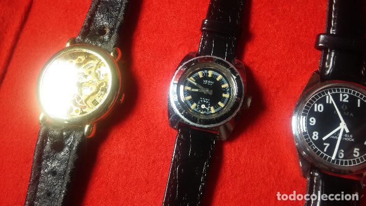 Relojes de pulsera: Botita cartera con reloj de cuerda Olma,los otros 7 relojes de cuerda que contiene se regalan - Foto 74 - 113733395