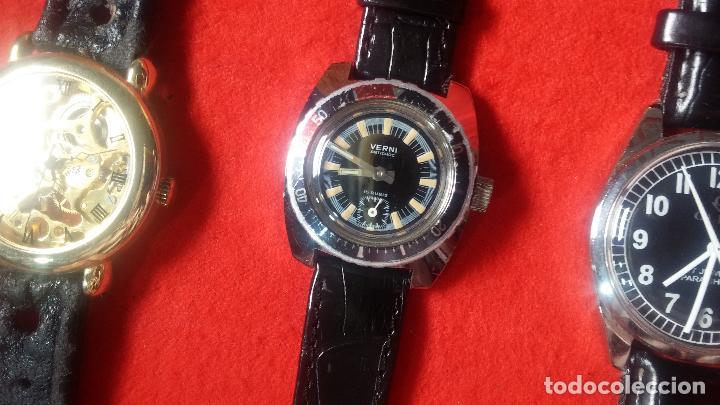 Relojes de pulsera: Botita cartera con reloj de cuerda Olma,los otros 7 relojes de cuerda que contiene se regalan - Foto 75 - 113733395