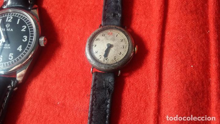 Relojes de pulsera: Botita cartera con reloj de cuerda Olma,los otros 7 relojes de cuerda que contiene se regalan - Foto 82 - 113733395