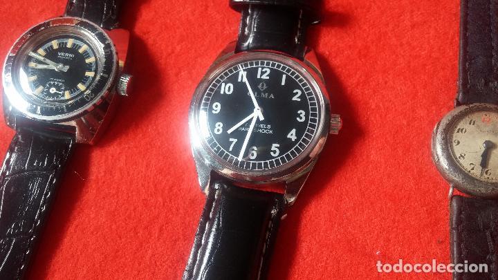 Relojes de pulsera: Botita cartera con reloj de cuerda Olma,los otros 7 relojes de cuerda que contiene se regalan - Foto 83 - 113733395