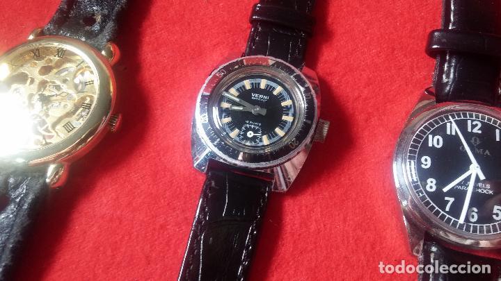 Relojes de pulsera: Botita cartera con reloj de cuerda Olma,los otros 7 relojes de cuerda que contiene se regalan - Foto 84 - 113733395