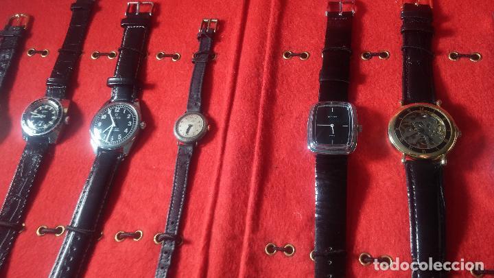 Relojes de pulsera: Botita cartera con reloj de cuerda Olma,los otros 7 relojes de cuerda que contiene se regalan - Foto 31 - 113733395