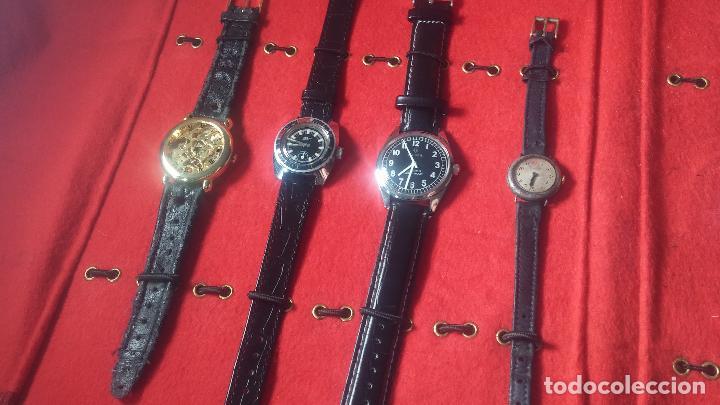 Relojes de pulsera: Botita cartera con reloj de cuerda Olma,los otros 7 relojes de cuerda que contiene se regalan - Foto 68 - 113733395