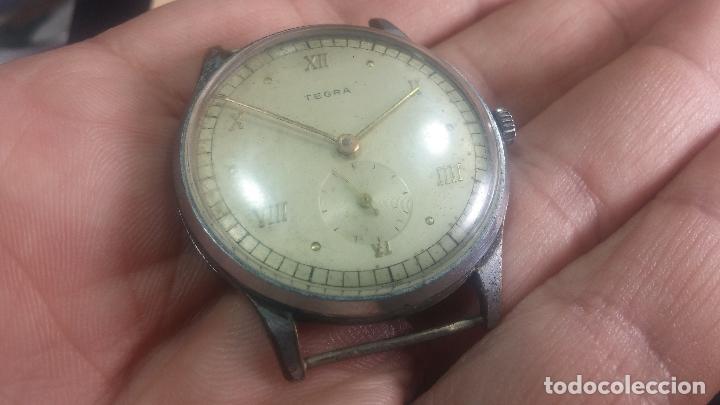 Relojes de pulsera: Botito y grande reloj TEGRA para reparar o para piezas. - Foto 11 - 124239283