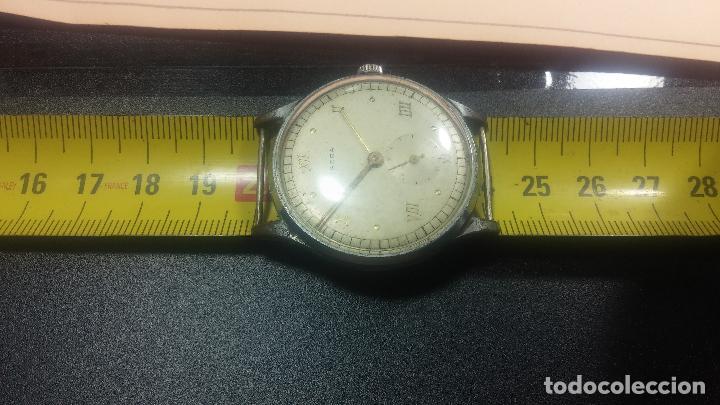 Relojes de pulsera: Botito y grande reloj TEGRA para reparar o para piezas. - Foto 27 - 124239283