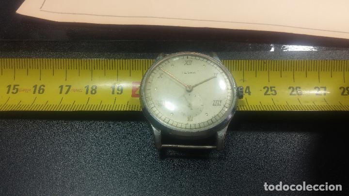 Relojes de pulsera: Botito y grande reloj TEGRA para reparar o para piezas. - Foto 28 - 124239283