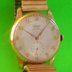 Relojes de pulsera: DOGMA MANUAL - AÑOS 60. P, ORO 10 M. FUNCIONANDO. 34.8 MM. S/C. LLEVA PULSERA ELASTICA. FOTOS.. Lote 134886594