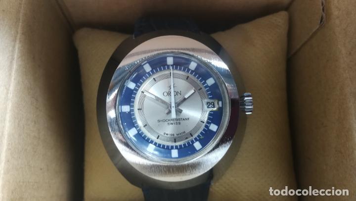 Relojes de pulsera: Botito reloj Orion grande de caballero con botita esfera azul marino, funcionando - Foto 5 - 139002582