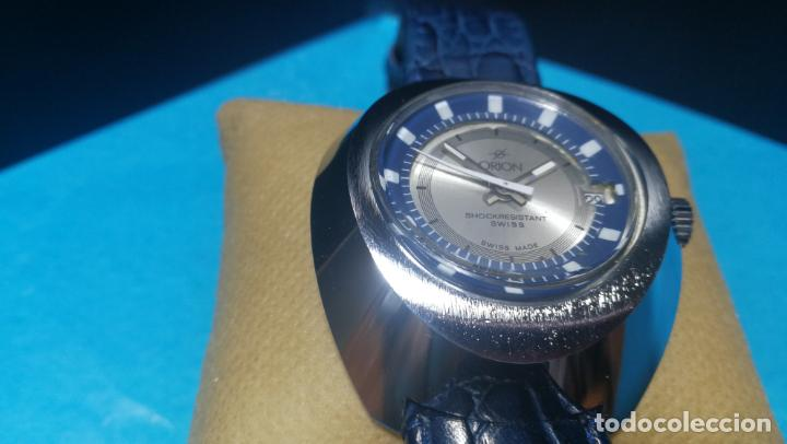 Relojes de pulsera: Botito reloj Orion grande de caballero con botita esfera azul marino, funcionando - Foto 27 - 139002582