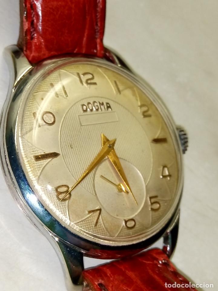 RELOJ DOGMA. AÑOS 50. FUNCIONANDO BIEN. 40 MM C/C. ESFERA TEXTURADA Y SERIGRAFIADA. DESCRIP. Y FOTOS (Relojes - Pulsera Carga Manual)