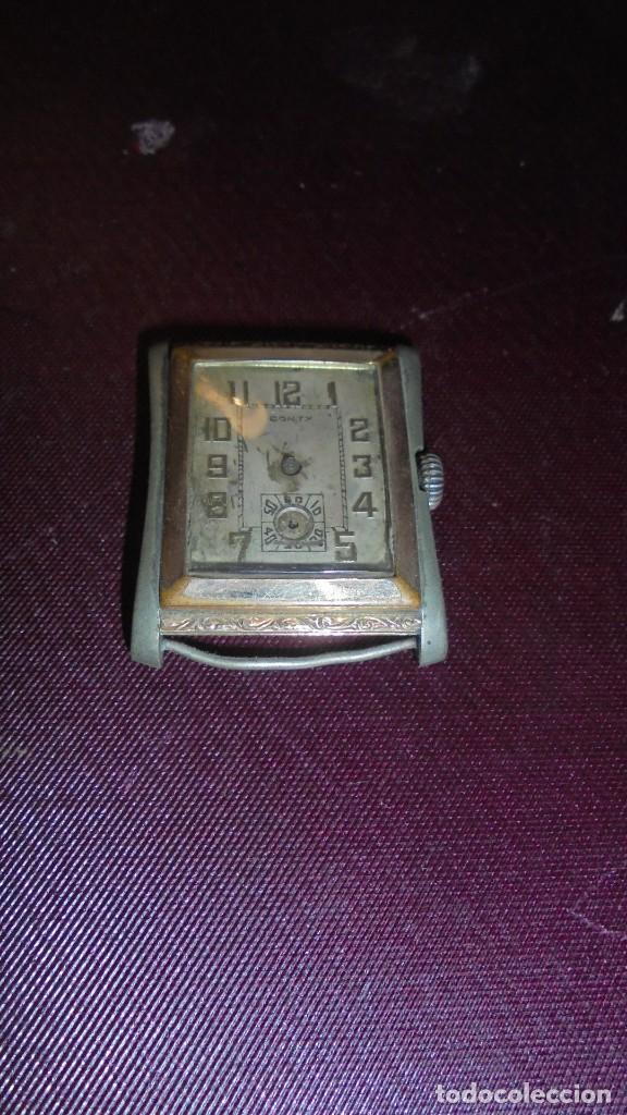ANTIGUO RELOJ A CUERDA MARCA CONTY PARADO Y LE FALTAN LAS AGUJAS 3,8X3 CM. (Relojes - Pulsera Carga Manual)