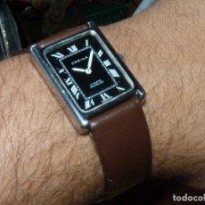 Relojes de pulsera: ELEGANTE RELOJ CARINA TIPO TANK CALIBRE RONDA RAX 6061-21 CUERDA MANUAL 17 RUBIS AÑOS 70. Lote 166714070