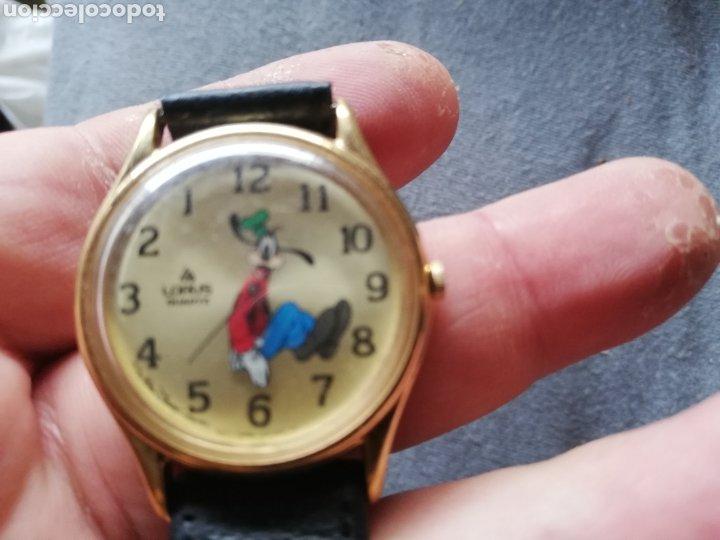 Relojes de pulsera: Reloj de pluto con marcaje de la hora al contrario del sentido normal del reloj.. Curioso - Foto 2 - 221166833
