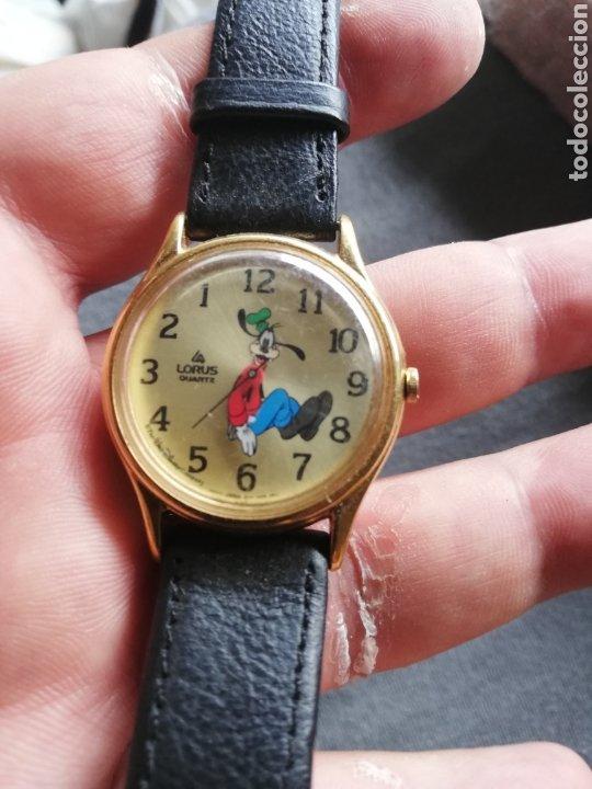 RELOJ DE PLUTO CON MARCAJE DE LA HORA AL CONTRARIO DEL SENTIDO NORMAL DEL RELOJ.. CURIOSO (Relojes - Pulsera Carga Manual)