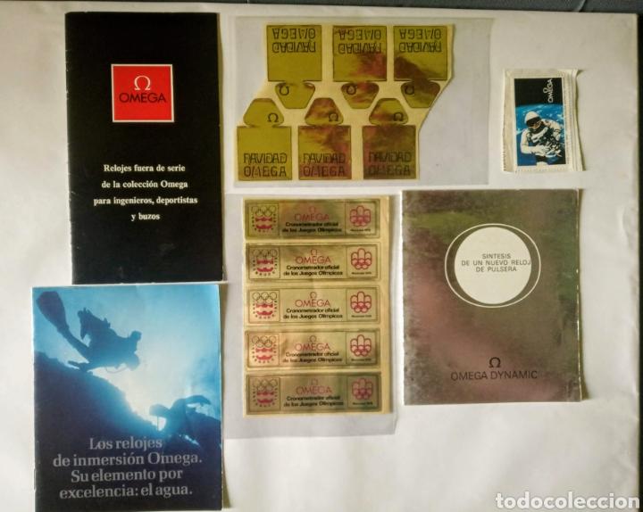 LOTE DE FOLLETOS PEGATINAS Y UN SELLO DE LA FIRMA OMEGA AÑOS 60/70 (VER BIEN FOTOS) (Relojes - Relojes Actuales - Omega)