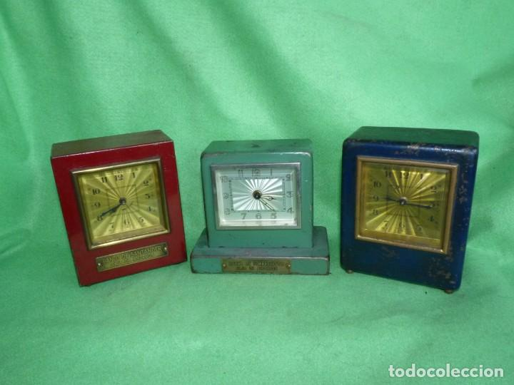 RARO LOTE RELOJ HUCHA BANCO SANTANDER TORRELAVEGA CAJA DE AHORROS NIZA MONTECARLO (Relojes - Sobremesa Carga Manual)