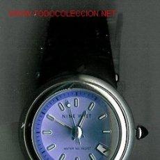 Relojes: BONITO RELOJ DE PULSERA MARCA NINE WEST, DE ACERO INOXIDABLE. ESFERA REDONDA GRANDE DE COLOR LILA. C. Lote 23750822