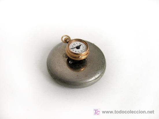 CURIOSO RELOJ DE SOLAPA DE OJAL DE ORO PRINCIPIOS S XX (Relojes - Relojes Actuales - Otros)