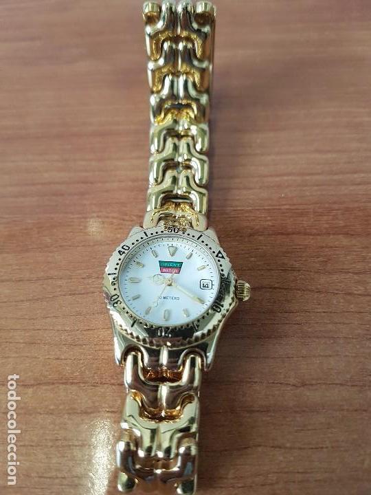 Relojes: Reloj de señora Orient con calendario de cuarzo chapado de oro, correa chapada de oro original - Foto 9 - 122653683