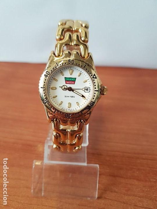 Relojes: Reloj de señora Orient con calendario de cuarzo chapado de oro, correa chapada de oro original - Foto 12 - 122653683