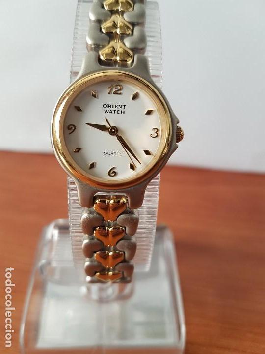 b20e87d3c5ef reloj señora orient redondo de cuarzo bicolor
