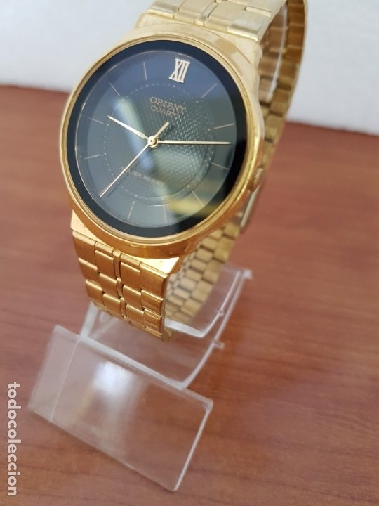 Relojes: Reloj (Unisex) marca Orient de cuarzo chapado de oro con correa chapada de oro, esfera negra - Foto 3 - 178371891