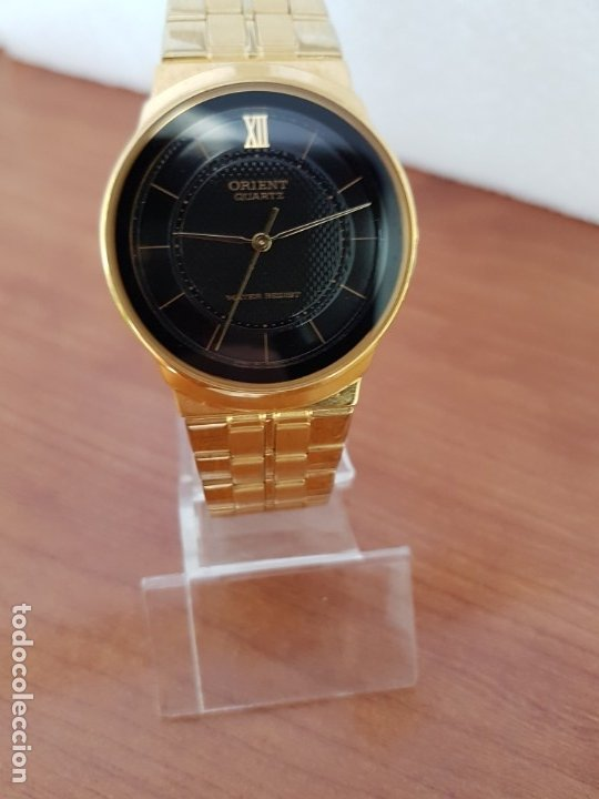 Relojes: Reloj (Unisex) marca Orient de cuarzo chapado de oro con correa chapada de oro, esfera negra - Foto 5 - 178371891