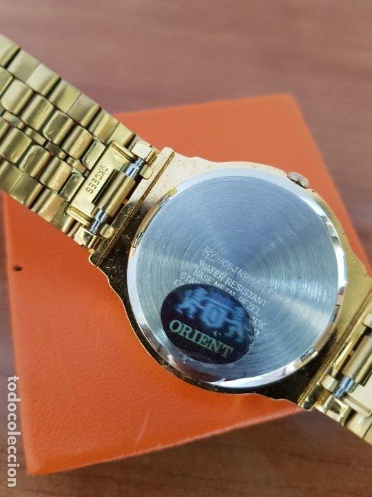 Relojes: Reloj (Unisex) marca Orient de cuarzo chapado de oro con correa chapada de oro, esfera negra - Foto 11 - 178371891