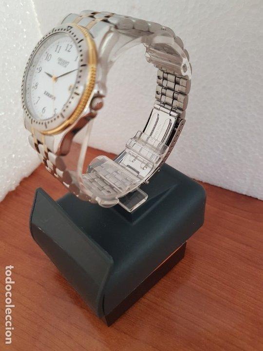 Relojes: Reloj de caballero ORIENT cuarzo acero y oro, esfera blanca, calendario las tres, correa acero oro. - Foto 9 - 178651967